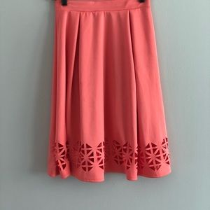 Dresses & Skirts - Coral midi skirt with cutout pattern
